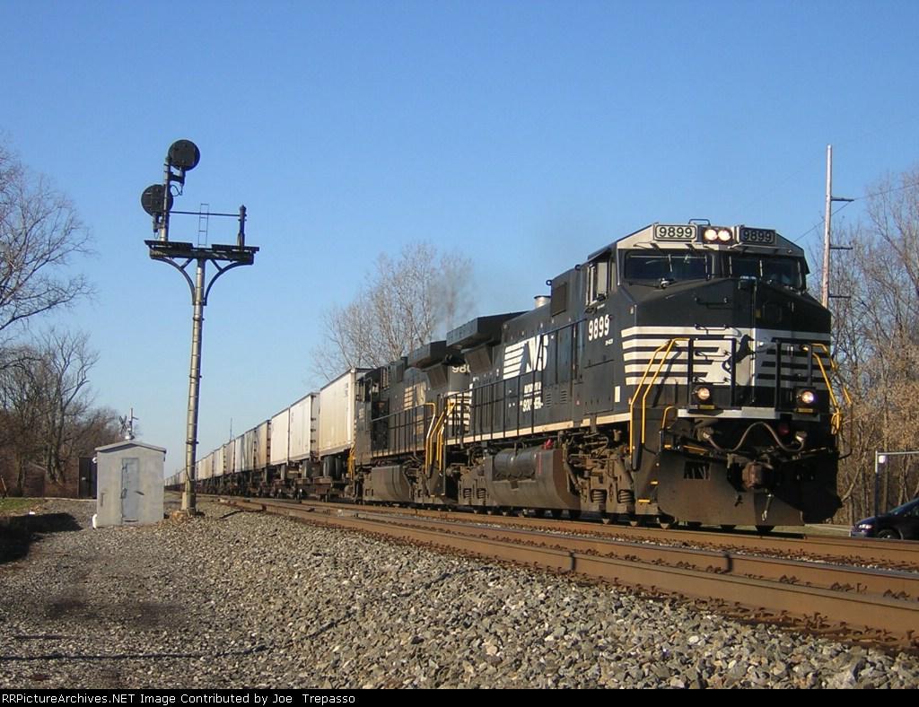 NS 9899 takes a piggyback train east.