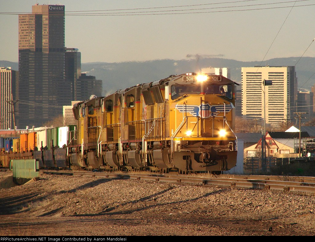 UP 5011 thundering out of downton Denver through Commerce City