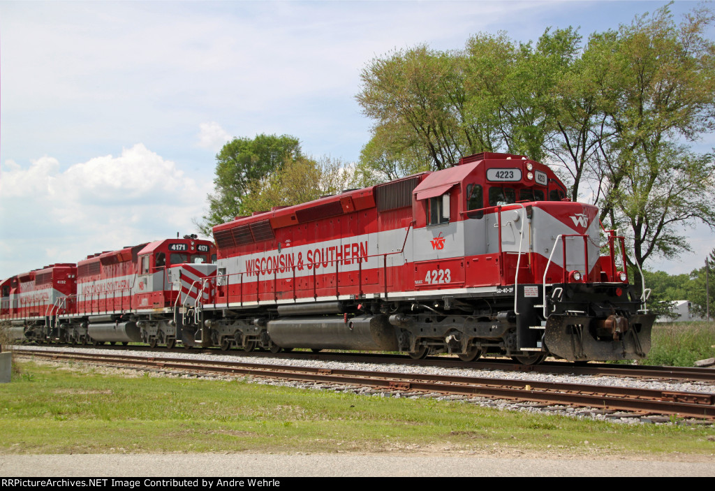 Three out of four red and gray units on this idling sand train
