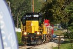WAMX 4219 in their yellow bonnet paint leads the OLS demonstrator train westbound
