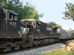 NS 8693 trailing 9137, on their way to Shenandoah with empty grain cars