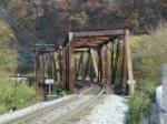Curved double span through truss bridge.