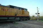 UP 9644 roars through a grade crossing on a hot august evening
