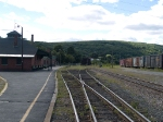 The station at 3:21pm (wide shot)