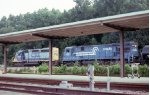 CSX SB freight with Conrail unit passing the passenger station