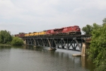 X500-13 crossing the Thornapple River with UP hybrids in tow
