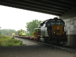 CSX 8053 hiding from the rain under Thornapple River Dr as the MOW crews load their equipment back onto the flatcars of D006