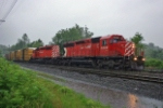 CP 5998 and 5951 head west in the rain
