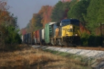 CSX 497 cruses through fall colors west of yard