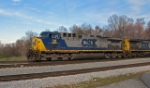 CSX 38 pulls empty hopper (coal) out of yard