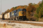 CSX 4562 cruses through fall folage east of yard