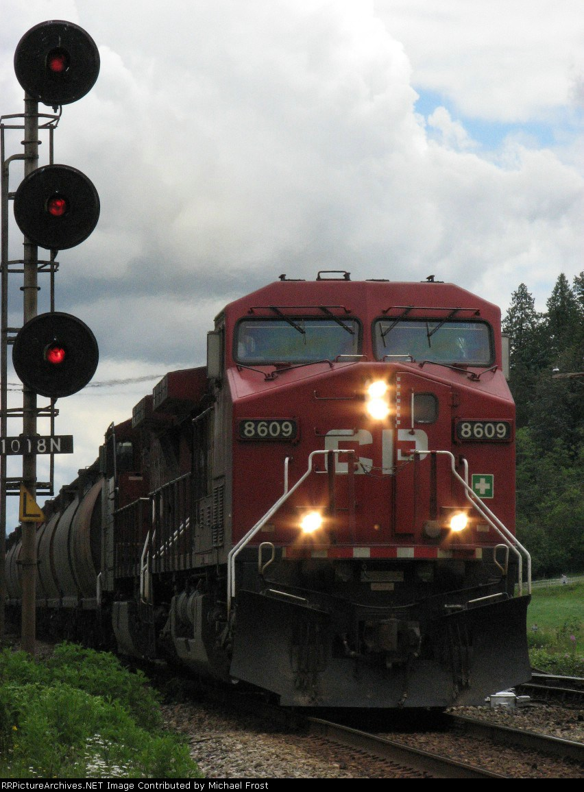 CP 8609 at head of westbound grain train