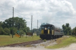 "Inland Lakes Railway Tourist Train the ""Mount Dora Champion"", with GE 45 Ton, Center Cab, Locomotive No. 101 ""Herbie"" in the lead,"