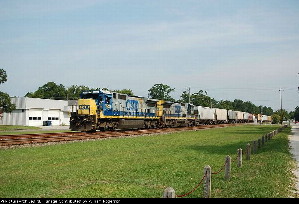 A pair of GE C40-8 Diesel Locomotives lead a CSX Transportation Mixed Freight Train Southbound