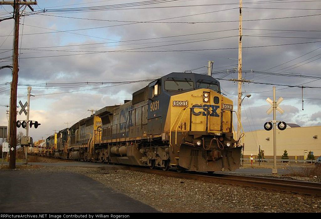 """Southbound CSX Transportation Mixed Freight Train, with GE C44-9W No. 9031 in the lead, on the """"River Line"""""""