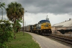 Southbound CSX Transportation (CSX) Mixed Freight Train, with GE C40-8W No. 7880 in the lead