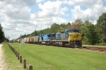 Northbound CSX Transportation Mixed Freight Train with a pair of GE C40-8W's providing power