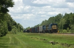Northbound CSX Transportation Mixed Freight Train with a pair of GE C40-8's providing power. No. 7506 is in the lead