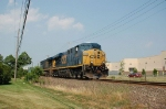 A pair of GE ES44DC Diesel Locomotives lead a CSX Transportation Container Train Southbound