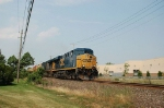 A pair of GE ES44DC Diesel Locomotives lead a Southbound CSX Transportation Mixed Freight Train