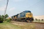 A pair of GE ES44DC Diesel Locomotives lead a CSX Transportation Mixed Freight Train Southbound