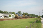 Three GE Diesel Locomotives lead a CSX Transportation Empty Container Train Southbound