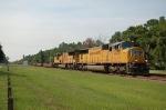 A pair of Union Pacific Railroad EMD SD70M Diesel Locomotives lead a Northbound CSX Transportation Empty Cantainer Train