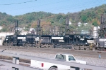 Consist of a coal train waiting by the shops