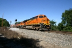 BNSF 7569 leads a stack train upgrade