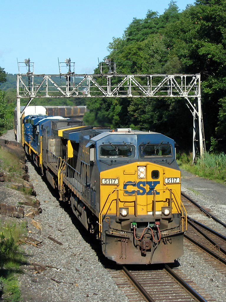 CSX 5117 With Brand New GEVOs Trailing
