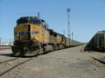 Loaded Unit train w/UP 5864 leading at west end of yard