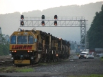 Loram RG306 waiting to go to work under the fading sun