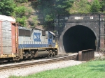 8525 bringing up the rear of Q217 as it exits tht tunnel