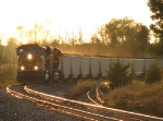 With the coal dust flying in the evening sun, N956-07 pulls hard around the curve