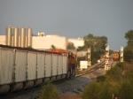 As Q327 waits in the siding, N956 rolls towards a clear signal