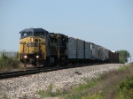CSX 7697 & 9020 leading Q326-13 over the top of the hill