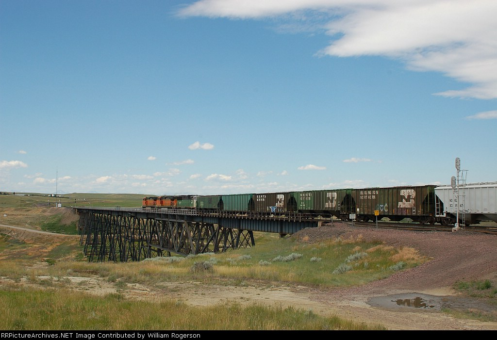 Westbound Burlington Northern Santa Fe Mixed Freight Train crosses the Bridge