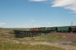 Westbound Burlington Northern Santa Fe Railway Mixed Freight Train crosses the Bridge
