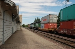 Westbound Burlington Northern Santa Fe Railway Container Train passes the Amtrak Depot