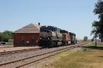 Three Burlington Northern Santa Fe Railway Diesels head Westbound passing the former Northern Pacific Railway Depot