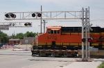 Burlington Northern Santa Fe Railway (BNSF) GE ES44AC No. 5773 leads a Northbound Freight Train through a crossing