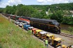 PRR 9880 & BAR 54 bring an excursion train to a stop while track car owners look on