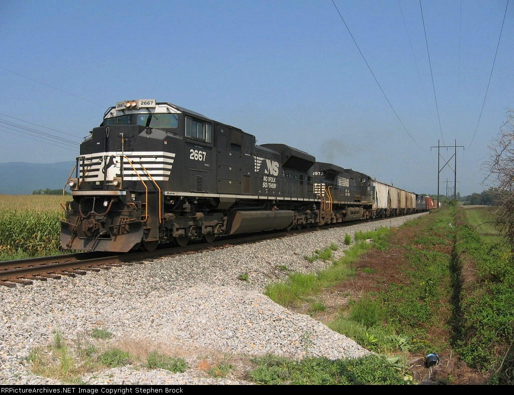 NS 2667 & 8973 Pull a light freight heading to Roanoke, VA.