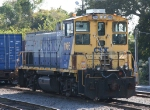 CSX 1166 sits with a cut of intermodal cars