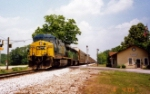 CSX 658 thunders past the Colbert depot with autoracks