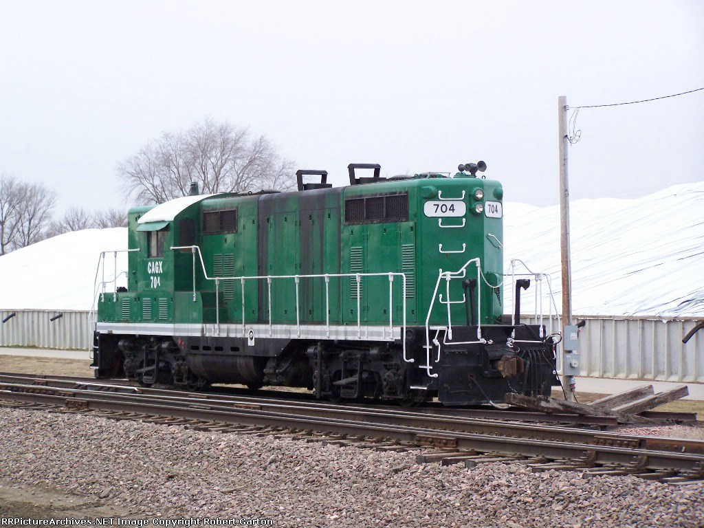 CAGX 704 Rests Near a Co-op Facility Along the NENE Line
