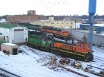 A Whole Host of Geeps and Switchers Sit in the Yard as Birds Scatter Overhead