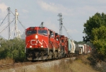 Westbound CN freight passing some elevators