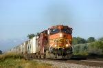 Eastbound grain train with all DM&E hoppers
