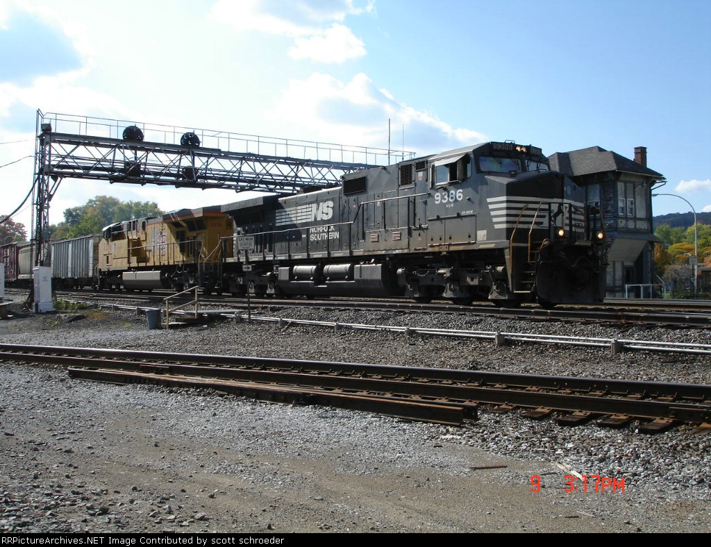 NS 9386 & UP 5256 head EB past ALTO Tower
